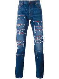 джинсы с рваными деталями Alexander McQueen