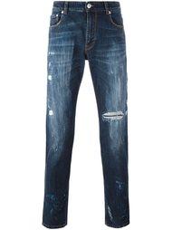 джинсы кроя слим с рваными деталями Versus