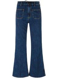 расклешенные джинсы Aries