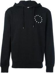 circular star print hoodie Études