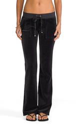 Велюровые брюки-клёш с карманами на кнопках - Juicy Couture