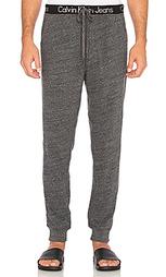 Спортивные брюки с логотипом на поясе - Calvin Klein