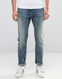 Синие джинсы с заниженным шаговым швом Nudie Brute Knut - Синий