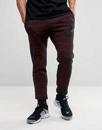 Красные джоггеры узкого кроя с принтом Nike 807265-013 - Красный