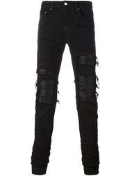 брюки с рваными деталями   Amiri