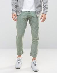 Суженные книзу брюки цвета хаки с эффектом кислотной стирки ASOS - Зеленый