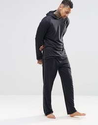 Зауженные штаны для дома с фирменной лентой Calvin Klein - Черный