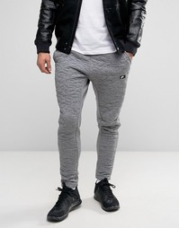 Серые джоггеры с вышивкой Nike 806691-091 - Серый