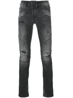 джинсы скинни с рваными деталями Pierre Balmain