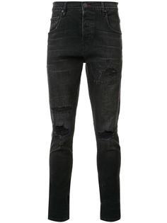 distressed skinny jeans En Noir