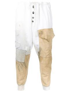 рваные спортивные штаны с заплатками Greg Lauren