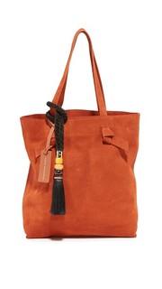 Объемная замшевая сумка с короткими ручками и кисточками ручной работы Lizzie Fortunato