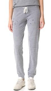 Винтажные меланжевые спортивные брюки с дырками Monrow