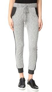 Спортивные брюки со вставками по бокам Beyond Yoga