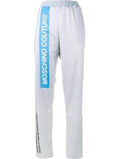 спортивные брюки с принтом 'pill packet' Moschino