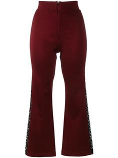 расклешенные брюки с кружевными вставками Ganni