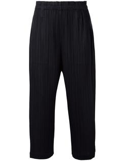 pleated tapered trousers Pleats Please By Issey Miyake
