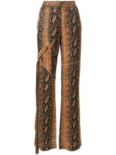 snakeskin print trousers Manning Cartell