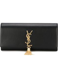 клатч с золотистым логотипом и кисточкой Saint Laurent