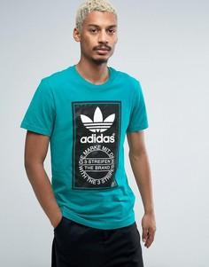 Футболка с камуфляжным принтом лейбла adidas Originals - Синий