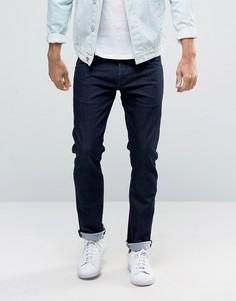 Слегка выбеленные джинсы слим с заниженной талией Wrangler - Темно-синий