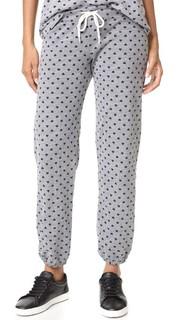 Винтажные спортивные брюки с изображением сердечек и рисунком в горошек Monrow