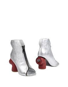 Полусапоги и высокие ботинки Mario Pini