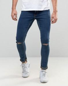 Темные супероблегающие джинсы с рваными коленями ASOS - Синий