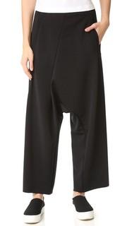Укороченные асимметричные брюки MM6