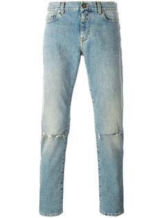 рваные джинсы кроя скинни Saint Laurent