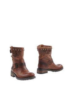 Полусапоги и высокие ботинки Giacko