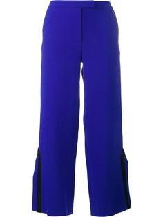 contrast trim side slit trousers Osman