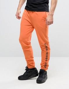 Оранжевые джоггеры скинни с готическим текстовым принтом ASOS - Оранжевый