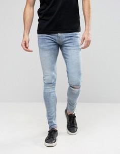 Супероблегающие джинсы с рваными коленями Ringspun - Синий