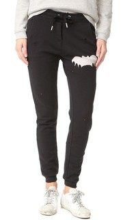 Спортивные брюки с эффектом поношенности и изображением летучей мыши. Zoe Karssen