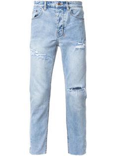 джинсы с рваными деталями Ksubi