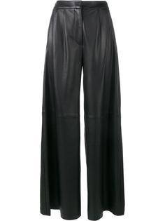 расклешенные кожаные брюки Adam Lippes