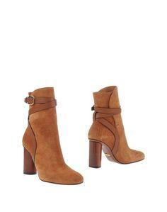 Полусапоги и высокие ботинки Gucci