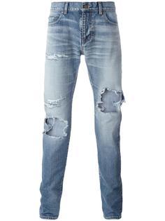 джинсы с потертым эффектом Saint Laurent