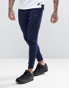 Синие флисовые джоггеры с принтом и заниженным шаговым швом Nike Tech 836416-408 - Синий
