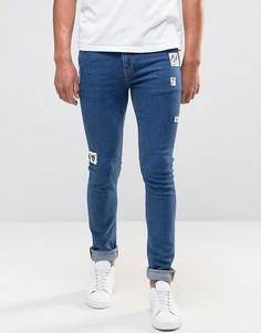 Синие выбеленные супероблегающие джинсы с нашивками ASOS - Синий