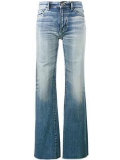 расклешенные джинсы с необработанными краями Saint Laurent