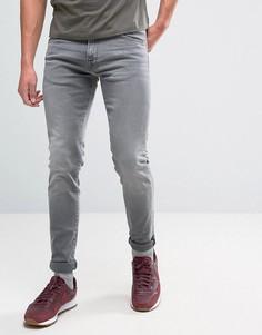 Суженные книзу джинсы с заниженным шаговым швом и эффектом поношенности Edwin ED-85 - Черный