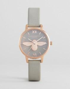 Розово-золотистые часы с серым кожаным ремешком и пчелой Olivia Burton - Серый