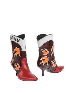 Полусапоги и высокие ботинки Miu Miu