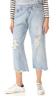 Укороченные джинсы с эффектом поношенности MM6