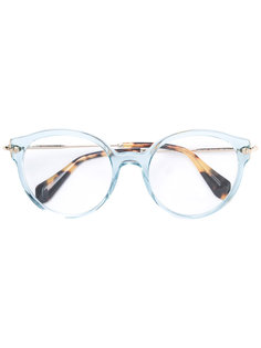 солнцезащитные очки круглой формы Miu Miu Eyewear