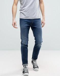 Темные зауженные джинсы с потертостями Diesel Tepphar 860L - Синий