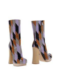 Полусапоги и высокие ботинки Prada