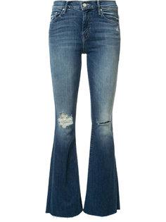 расклешенные джинсы с рваной отделкой Mother